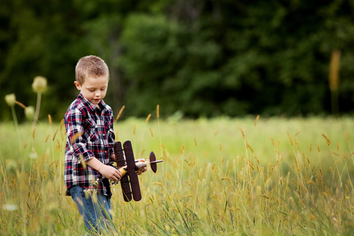 A child plays with his heirloom airlplane while I photograph him
